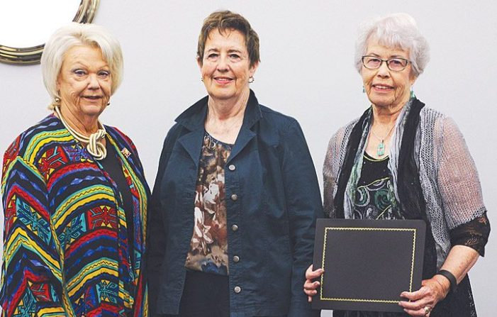 Addison family members receive heritage award