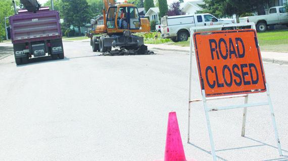 Paving crews working on roads in Kindersley