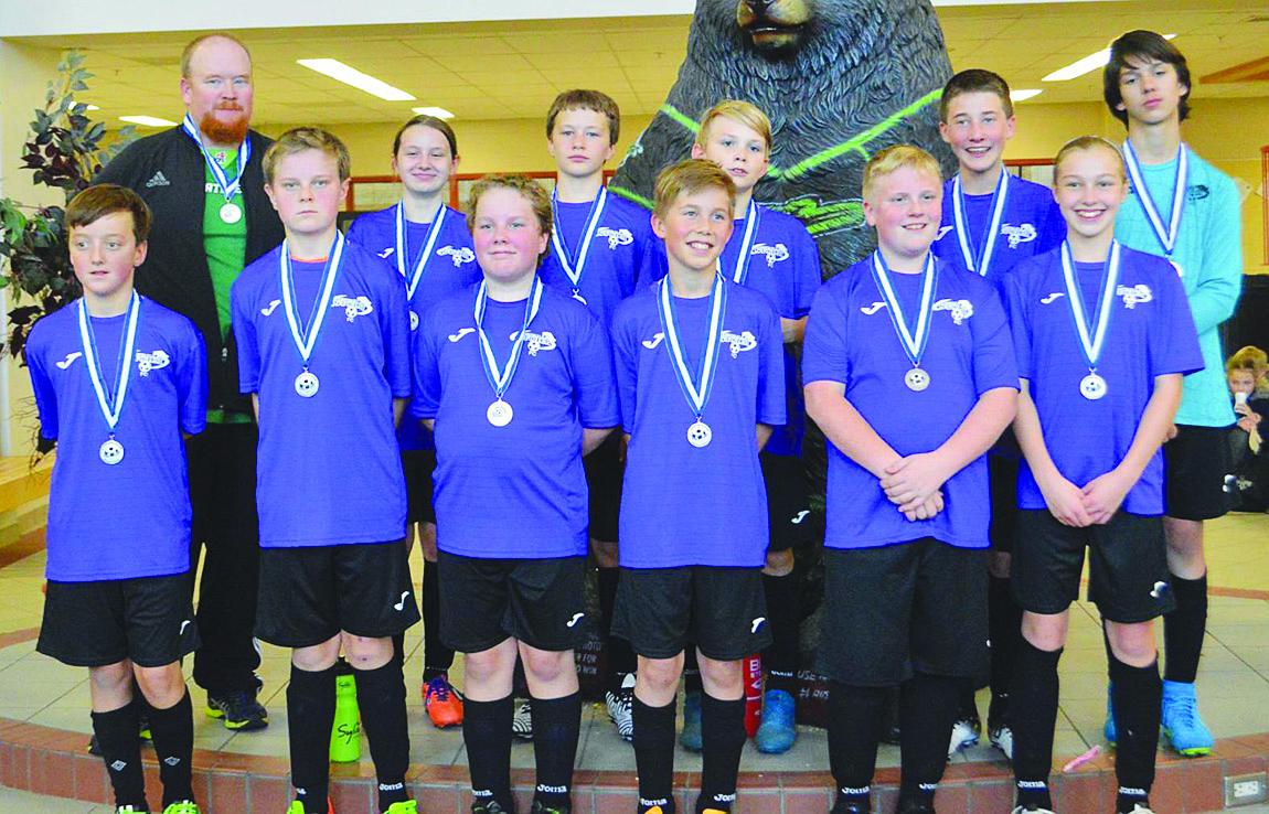 Storm teams kick off indoor soccer season with medals