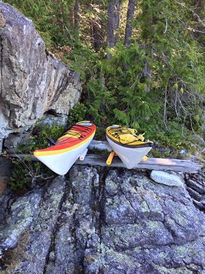 Kayaks at rest above high tide line at Skelhp